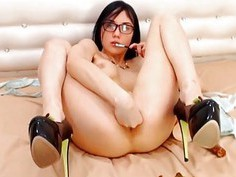 Sexy Babe in Glasses Rides her Dildo