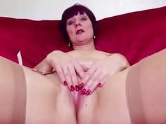 Redhead mature masturbating in tan stockings
