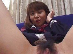 Alluring Japanese Kanako plays with big toys on the couch