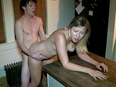 Amateur blonde cutie enjoys doggy style session in the kitchen