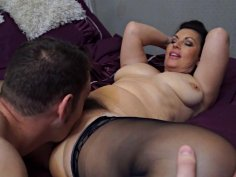 Chunky MILF in stockings plays with her hung boy toy