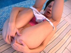 Inge licks her small titties and plays with her pussy by the pool