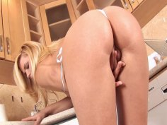 Sexy blonde Yasmine playing with her pussy in the kitchen