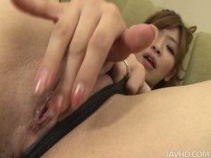 Very horny Japanese babe Koda Riri plays with her snatch on the couch