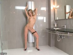 Lascivious blonde Jada Fire shows her curves in the restroom