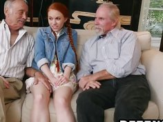 Young redhead spreads legs and rams older stud