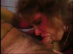 Repulsive frizzy old hobo Angela pleases two dicks in the tunnel
