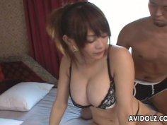 Bosomy redhead Japanese girl Rina Wakamiya gives titjob