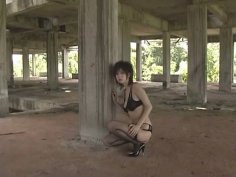 Teen chick Aki Hoshino in sexy fishnet stockings poses for photoshoot